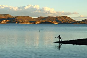 A person fishing at Lake Pleasant, a reservoir north of Phoenix, Arizona