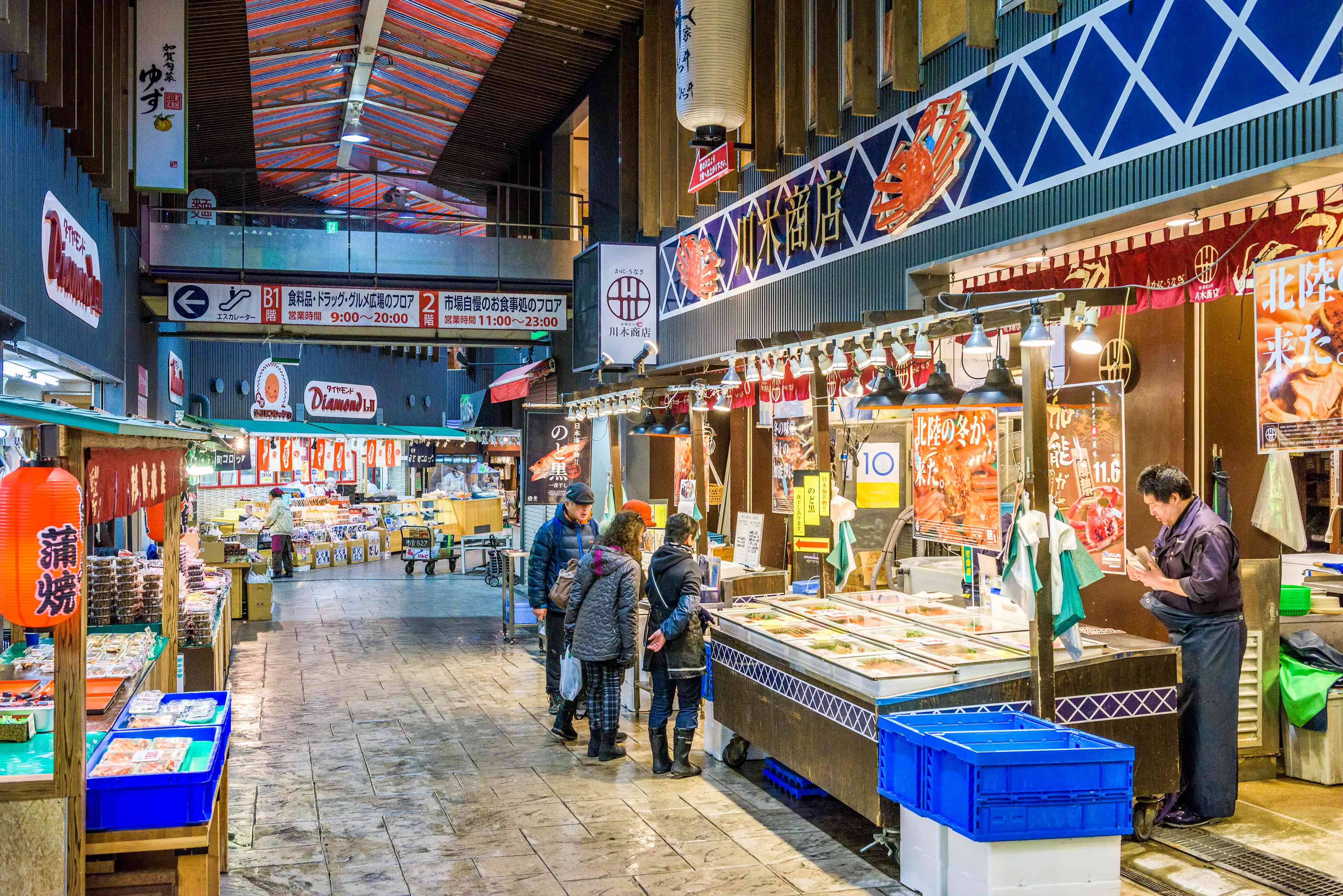 Early morning shoppers peruse fresh seafood at the the Omicho Market in Kanazawa, Japan.