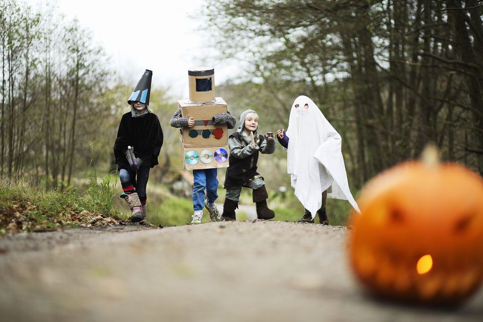 kids playing in a forest during halloween