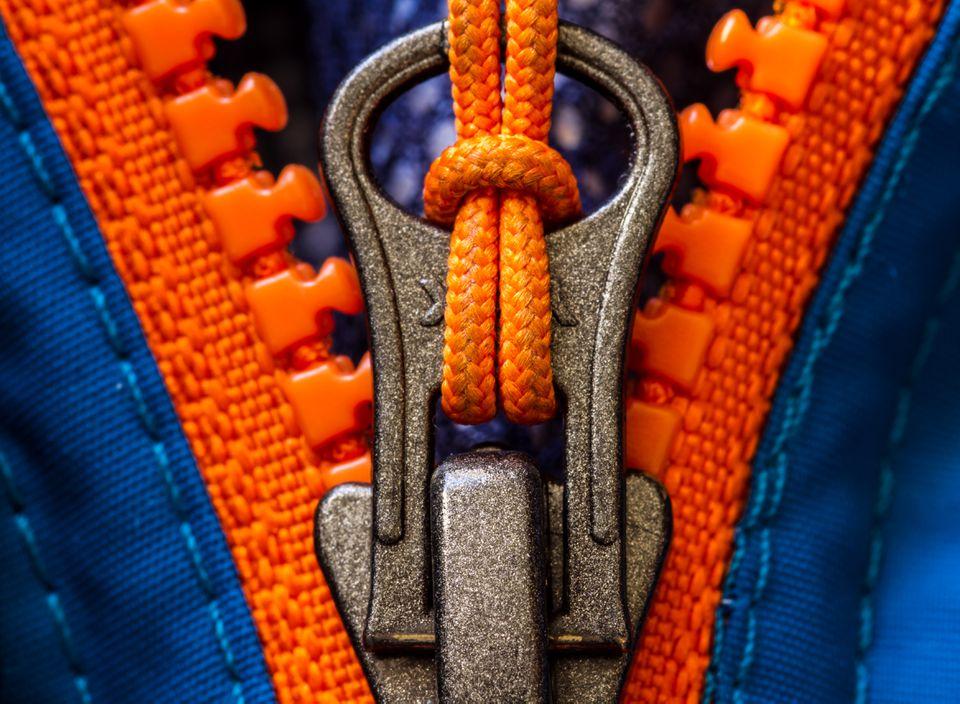 Orange zip on a blue jacket