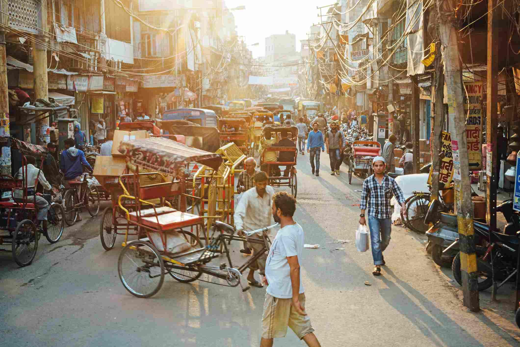 People walking around Old Delhi street.