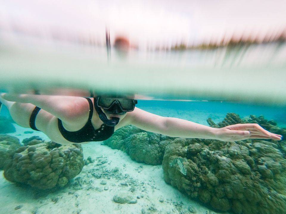 A woman snorkeling in Tahiti