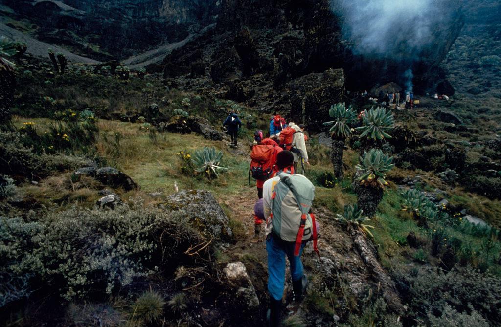A hiking group reaches a camp on Mount Kilimanjaro in Kilimanjaro National Park, Tanzania.