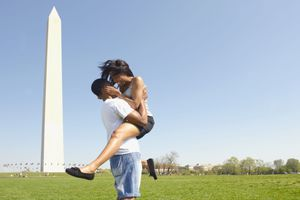 African American couple hugging near Washington Monument, Washington, DC