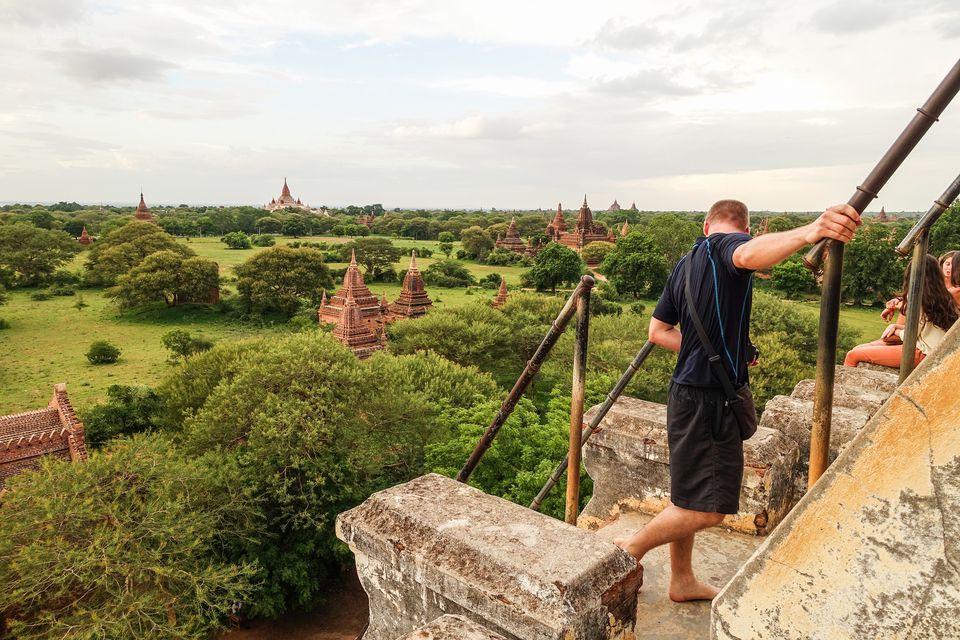Tourist climbing Shwesandaw in Bagan