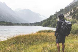 Man in rain jacket looking at mountains