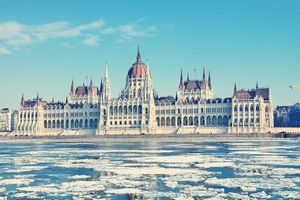 Frozen Danube River By Hungarian Parliament Building Against Blue Sky