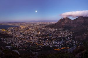 South Africa, Cape Town, panoramic view of cape town with signal hill and table mountain seen from lion's head at full moon
