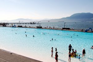 People enjoy a late afternoon swim at Kits Pool in Vancouver, BC