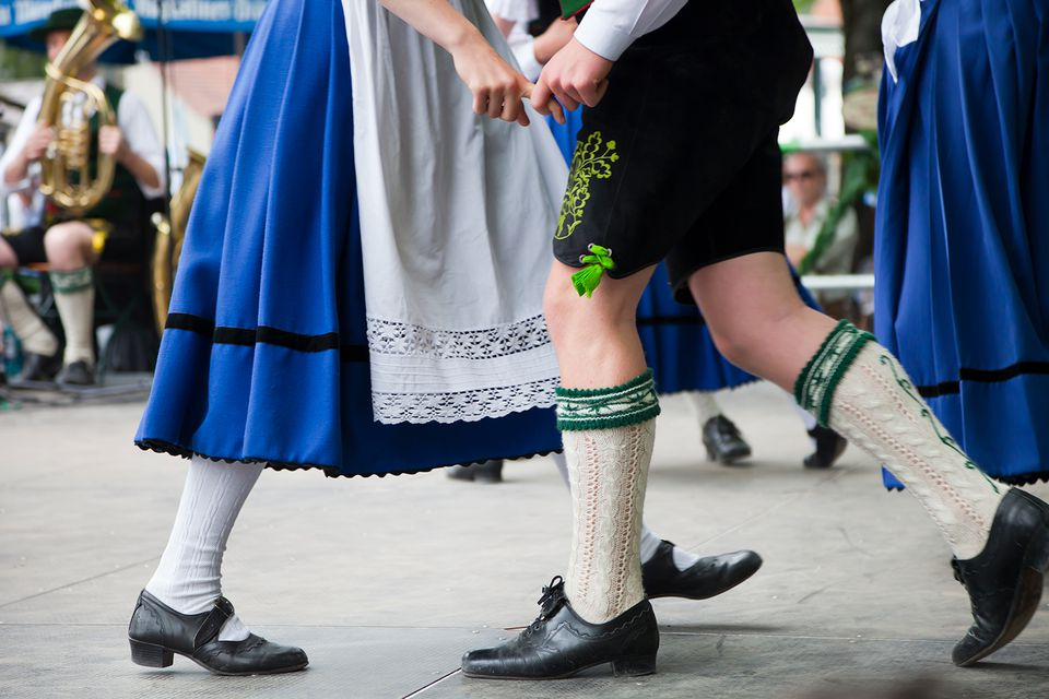 bavarian couple dancing at oktoberfest