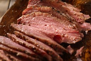 Close up of smoked meat on cutting board.