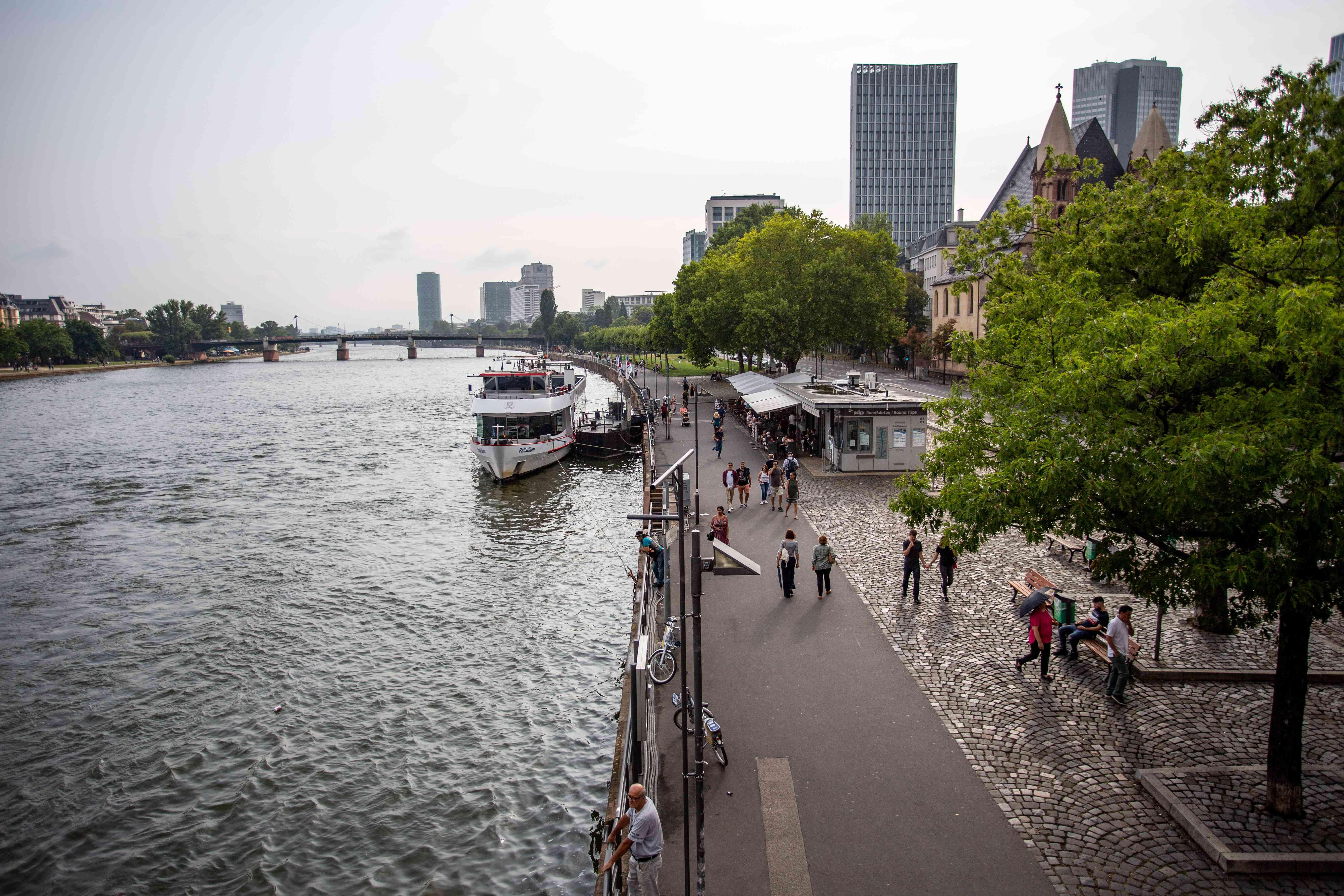 People walking along the river embankment