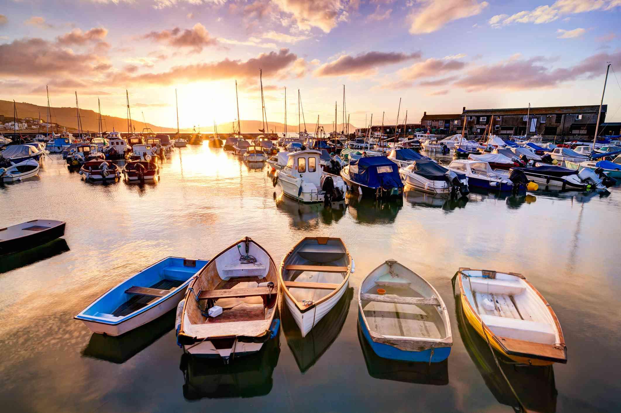 Dozens of boats at Lyme Regis Harbour at Sunrise