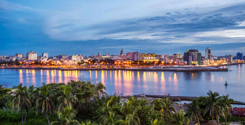 Havana city by sea against sky during sunset. Cuba