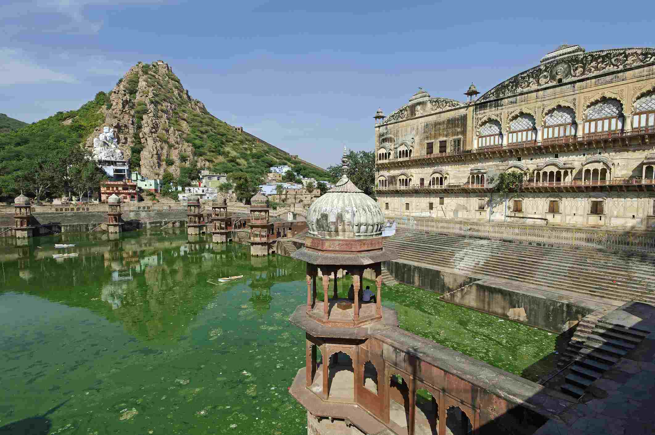 India, Rajasthan, Alwar. A large water tank with pleasure pavilions stands behind Alwar's City Palace