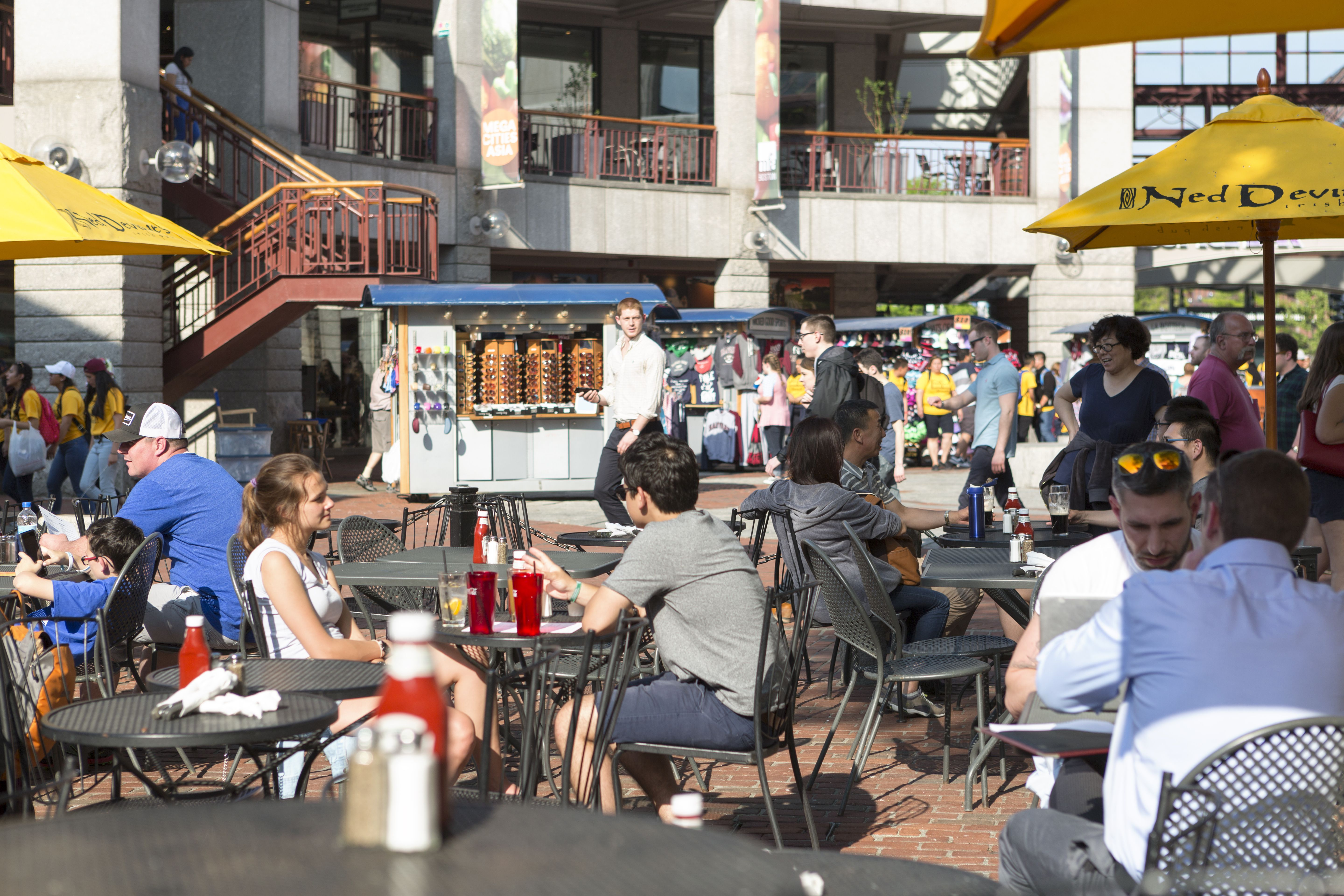 Locals eating at food stalls outside Quincy Market