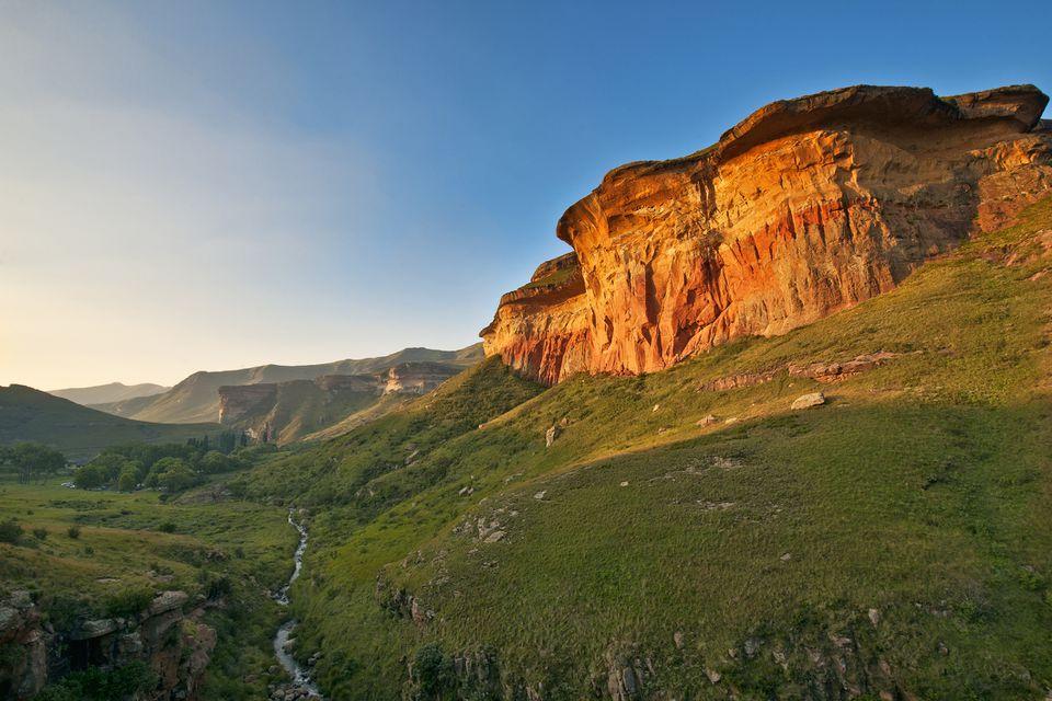 Sun setting on sandstone rock formations in Golden Gate Highlands National Park