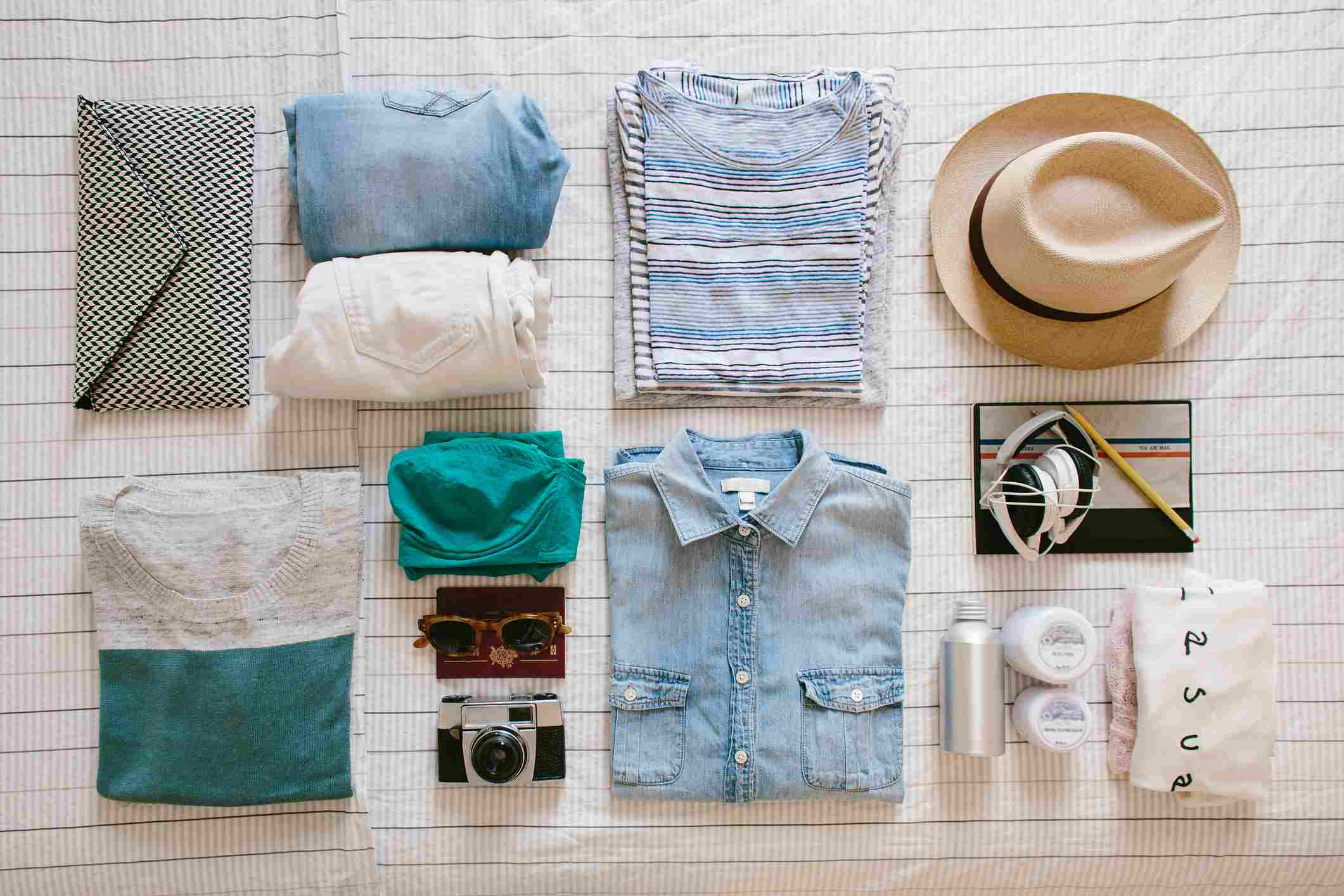 Holiday packing neatly prepared on bed