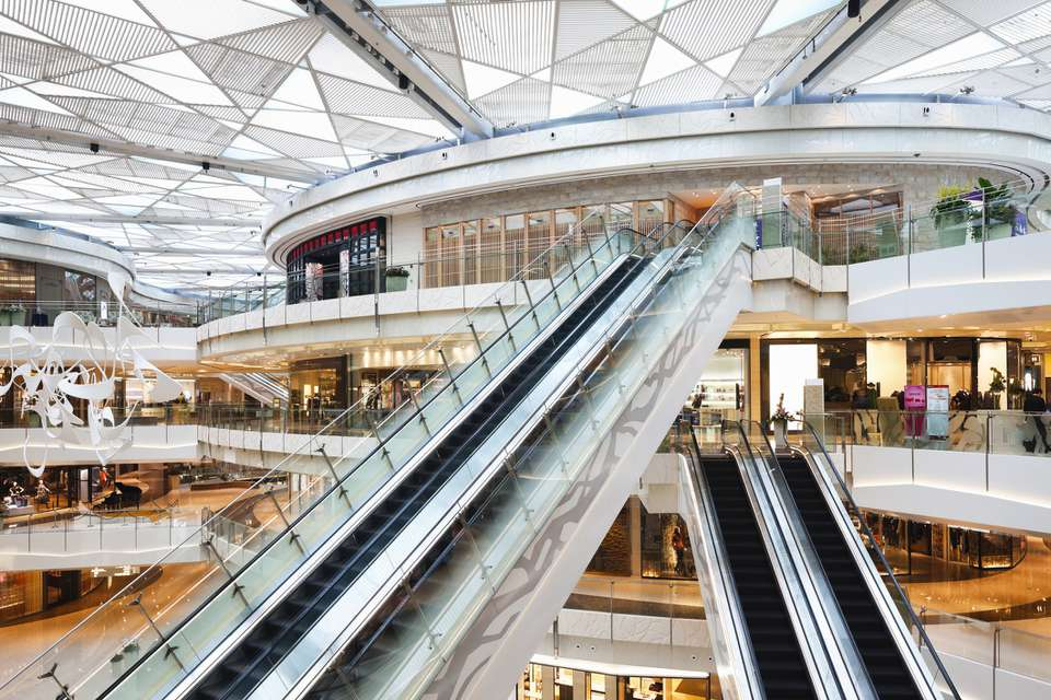 Escalators to ferry passengers up and down at the IFC shopping mall in Shanghai, China. The mall includes six floors of luxury stores, restaurants, and a cinema.