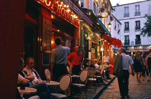 Cafe patrons stare at passersby, passersby stare at patrons. Thus is life at the Parisian cafe.