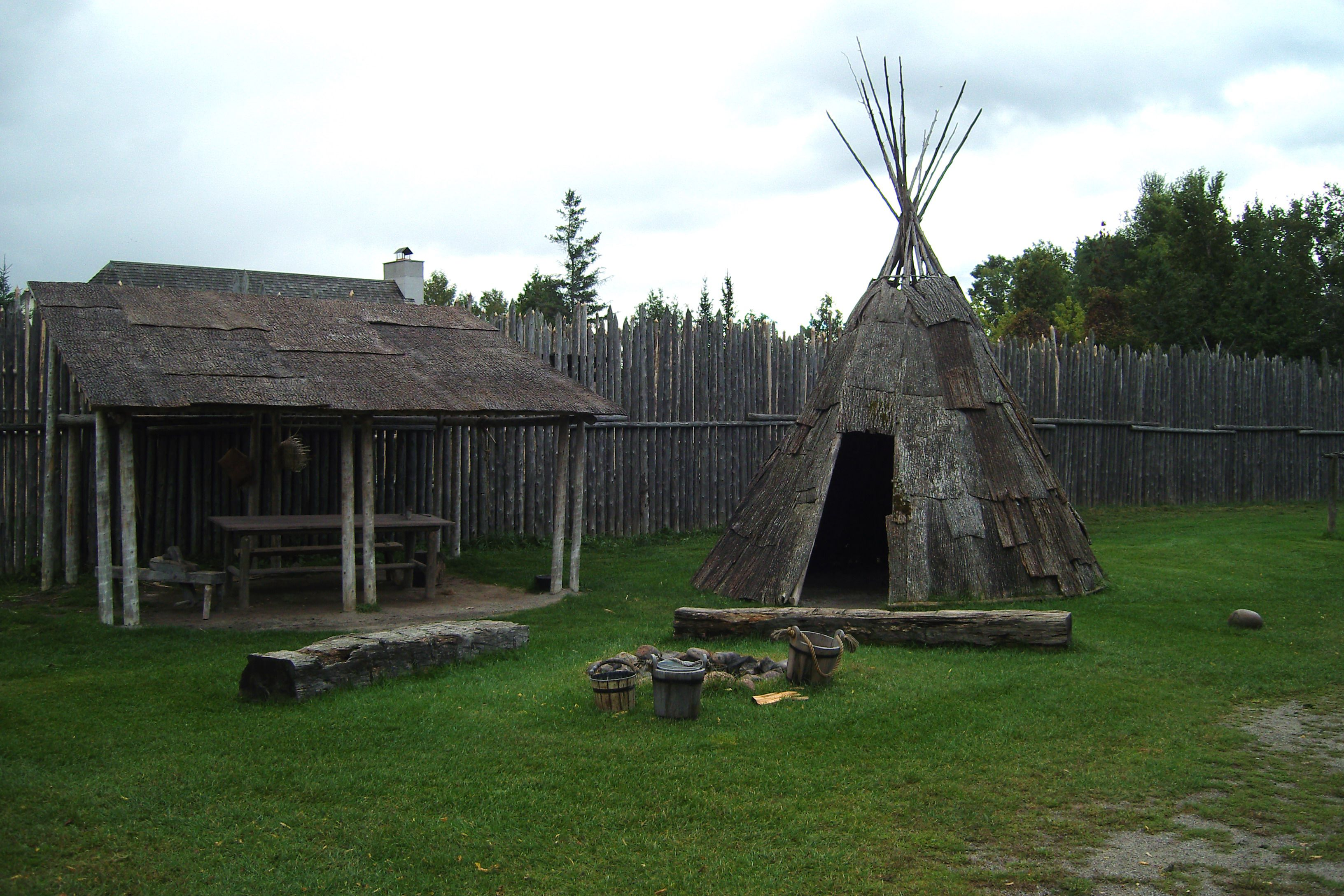 """A reconstructed wigwam, or shelter covered in bark, found in the """"Native Area"""" of the site, Saint Marie Among the Hurons."""