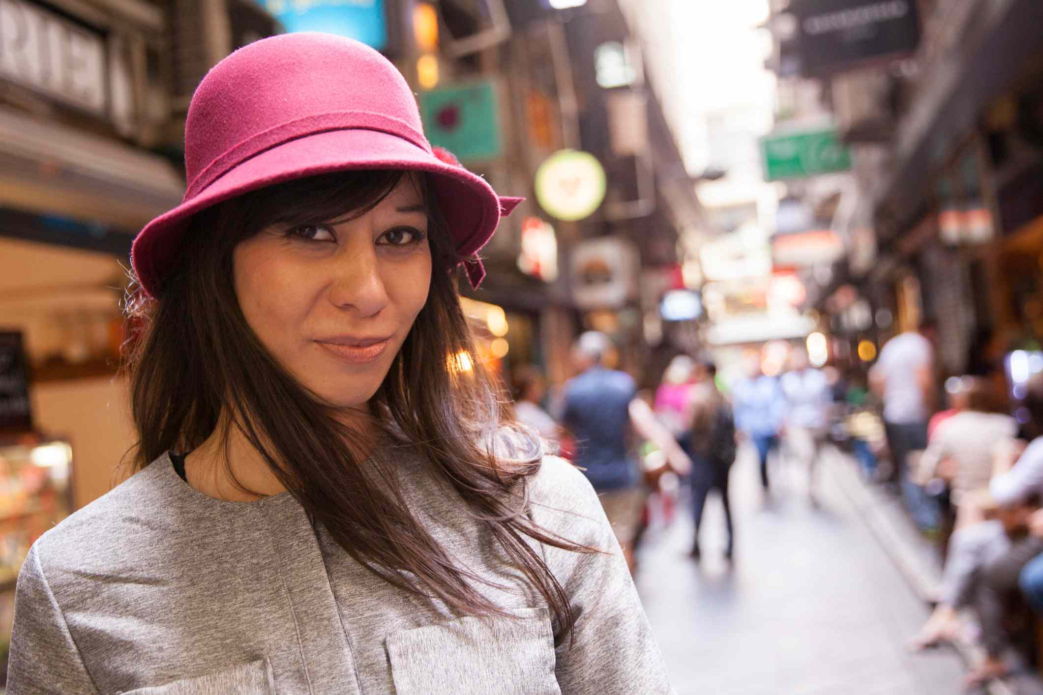 woman in a pink hat on a Melbourne street