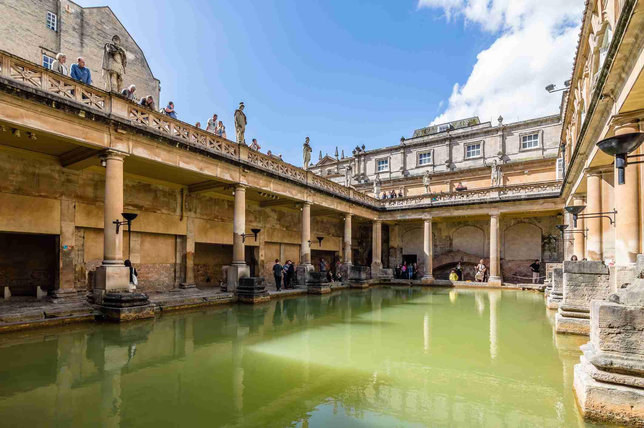 Tourist At Roman Baths On Sunny Day Against Sky