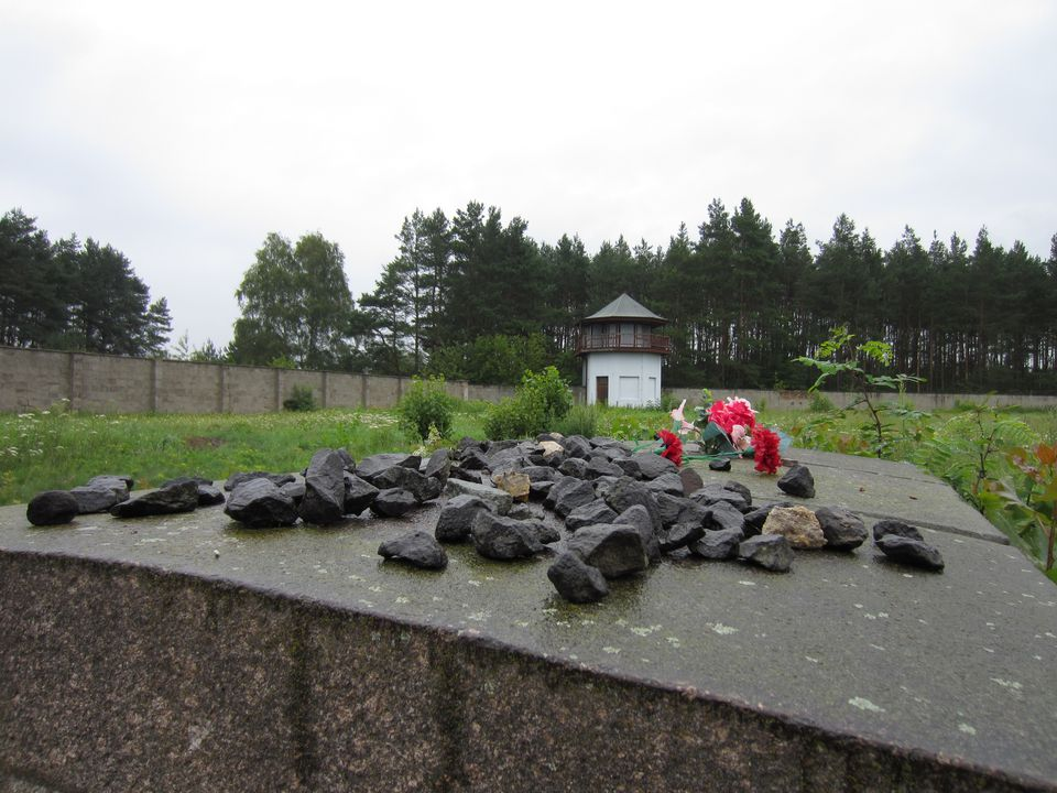 Stones and flowers mark a grave at Sachsenhausen Concentration Camp