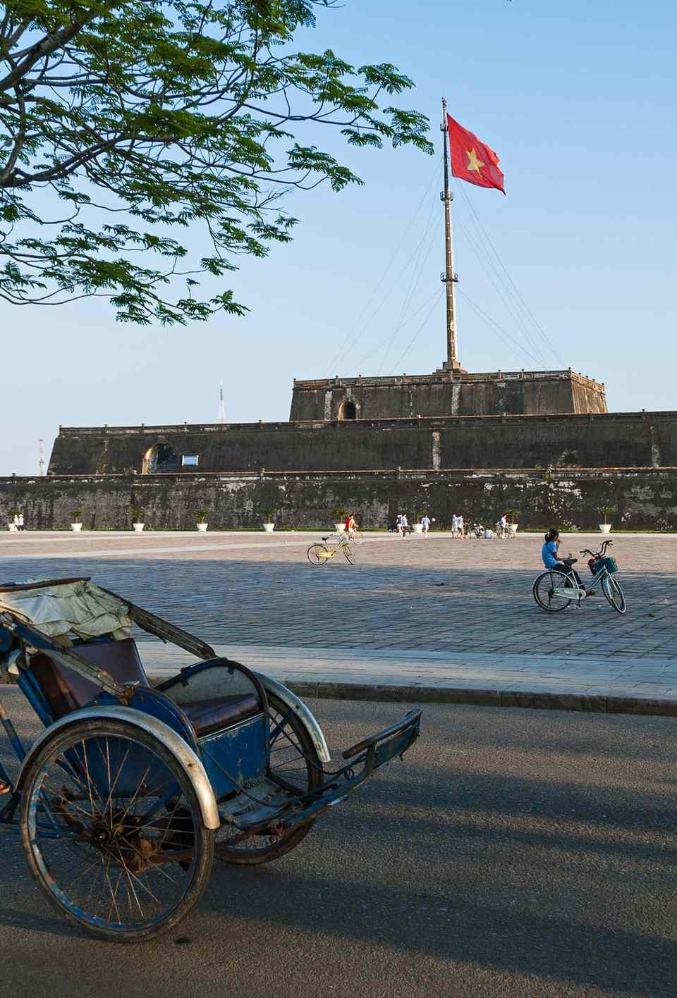 Cyclo driver in front of Hue Citadel, Vietnam