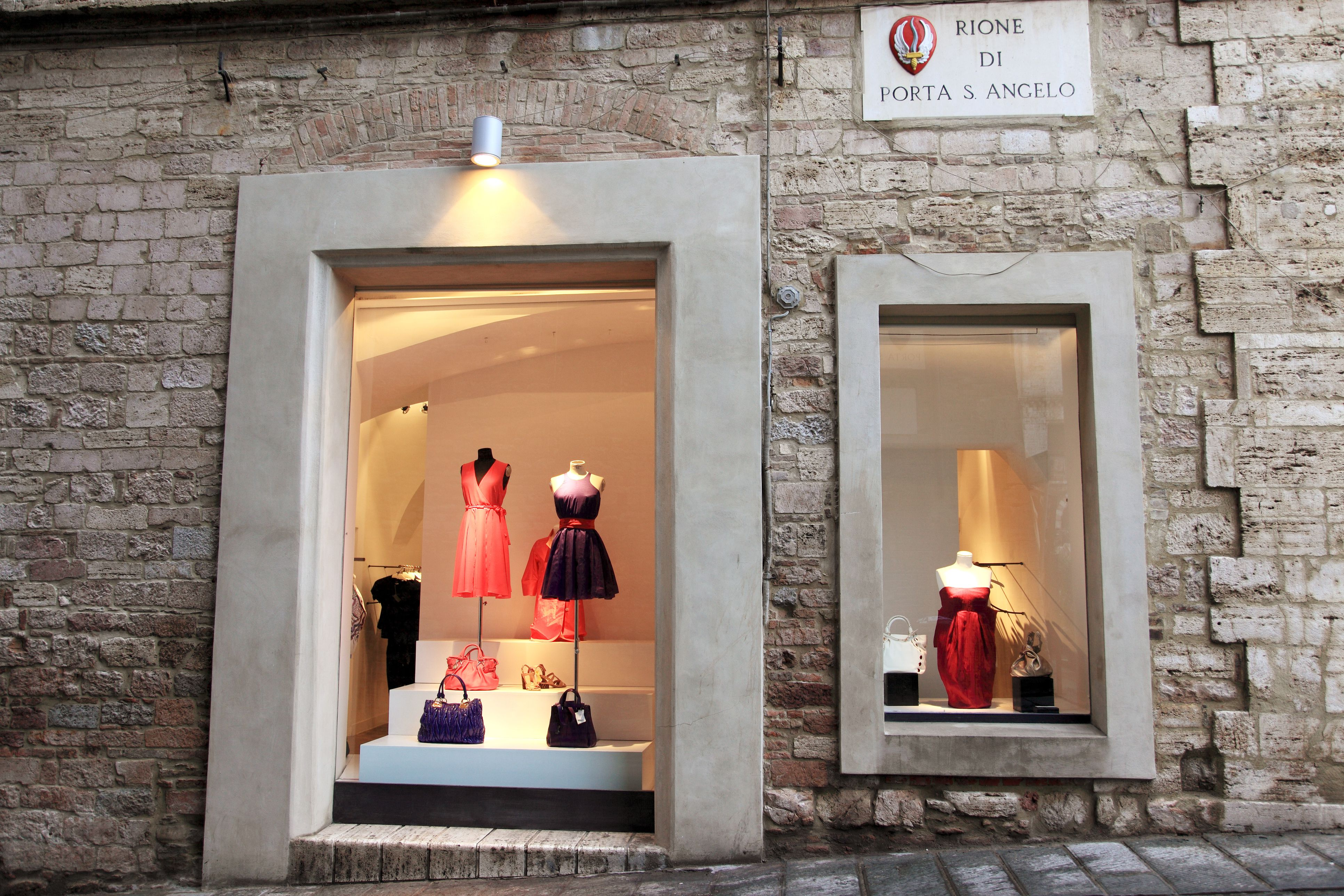 Fashion items and accessories displayed in shop window.