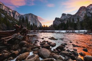 Yosemite's Gates of the Valley at sunset with a light dusting of snow on the ground