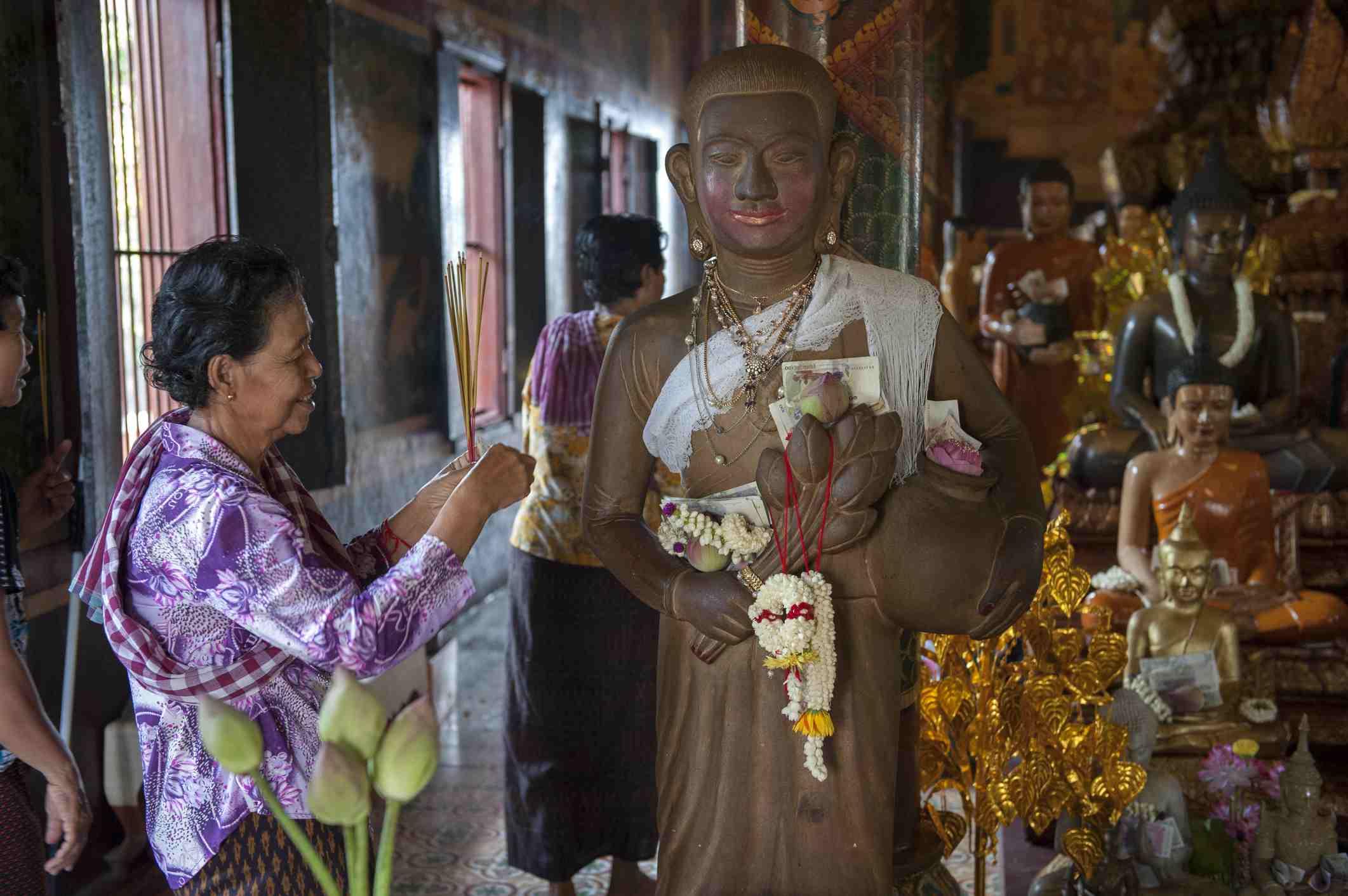Woman worshiping at Wat Phnom, Cambodia