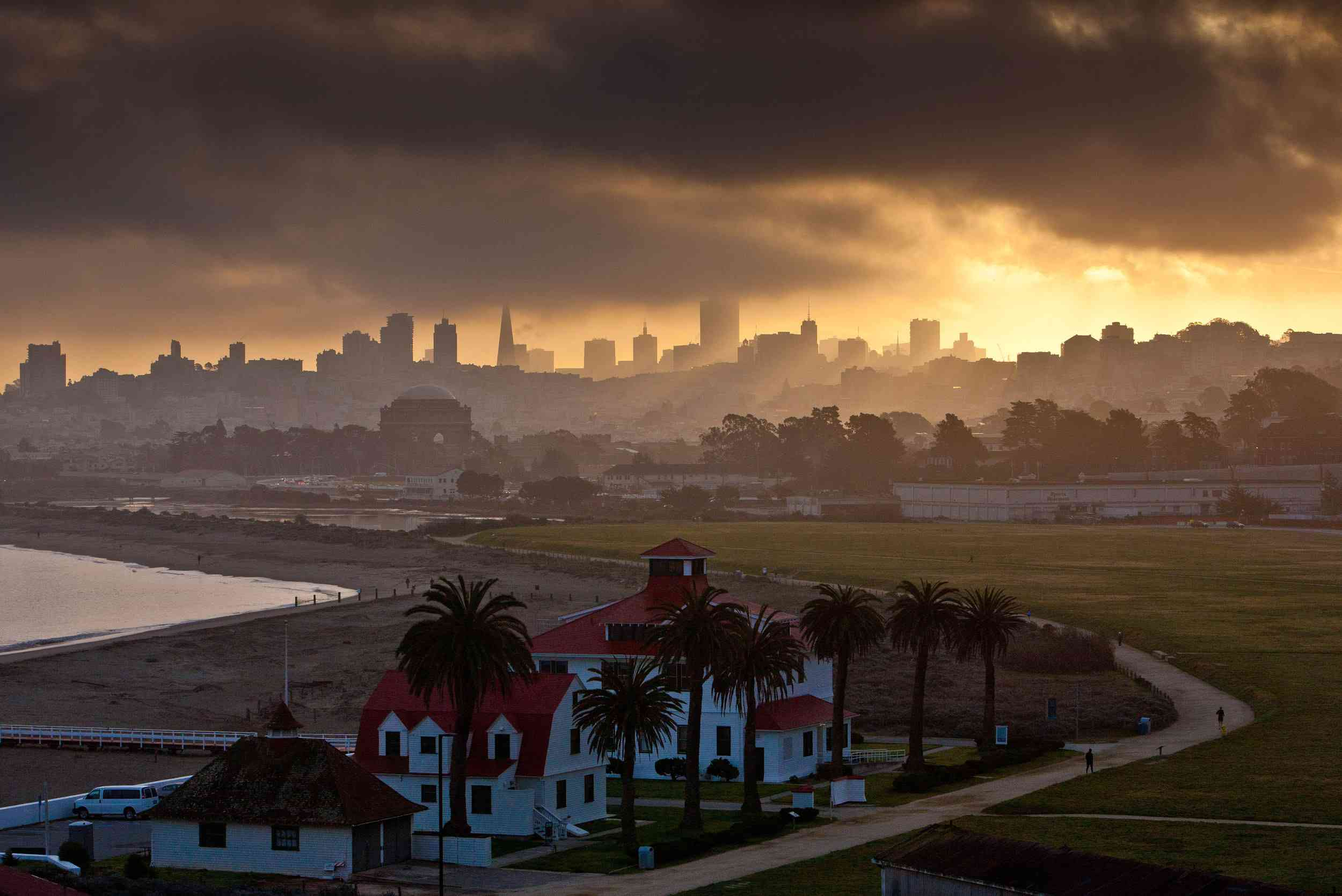 The Presidio of San Francisco at sunset, with the skyline just visible through fog
