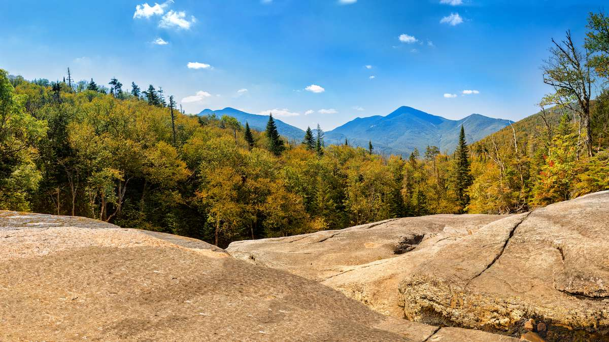 The Adirondack Mountains line the horizon from a New York state hiking trail.