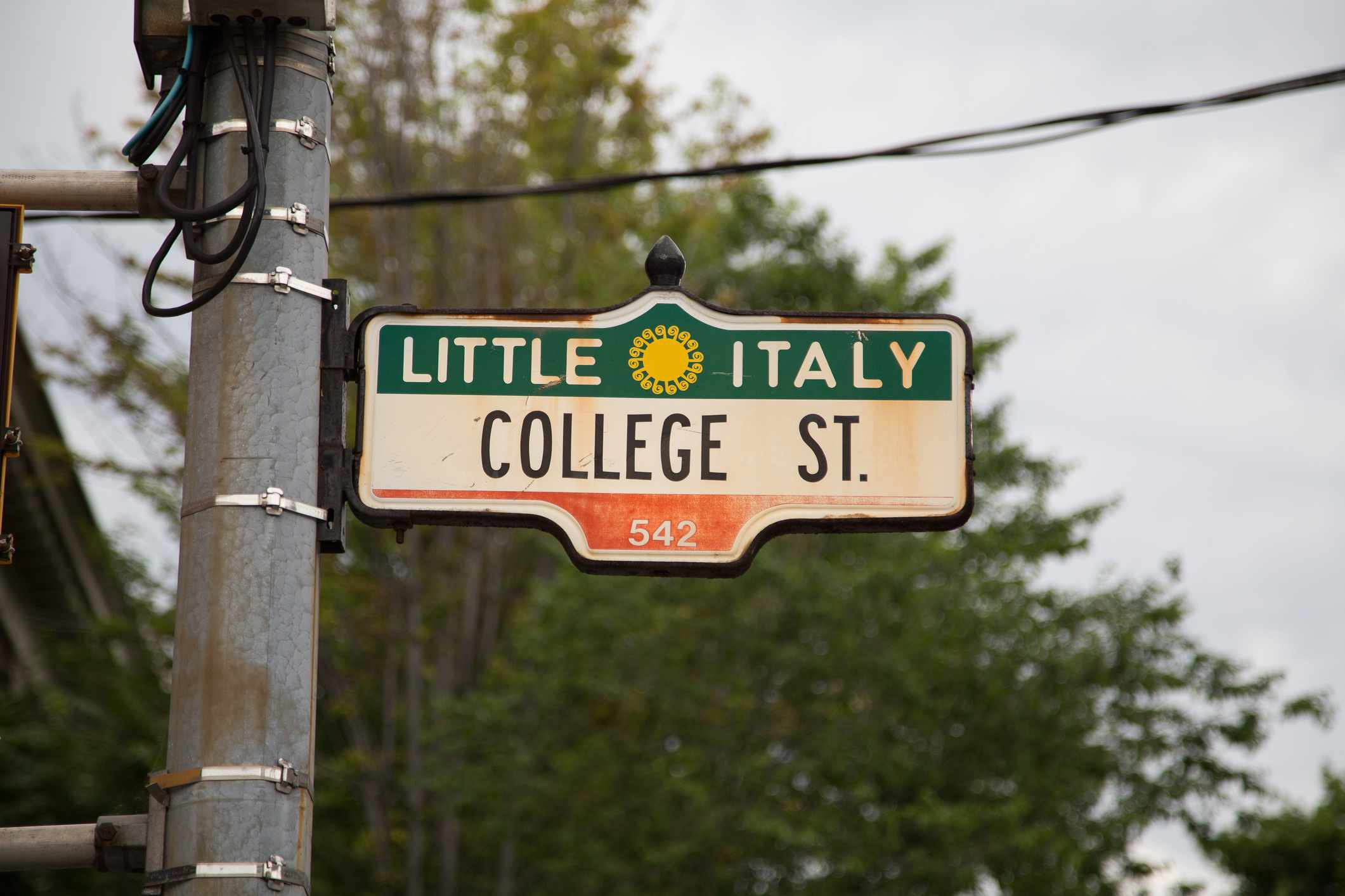 A sign for Little Italy on College Street in Toronto