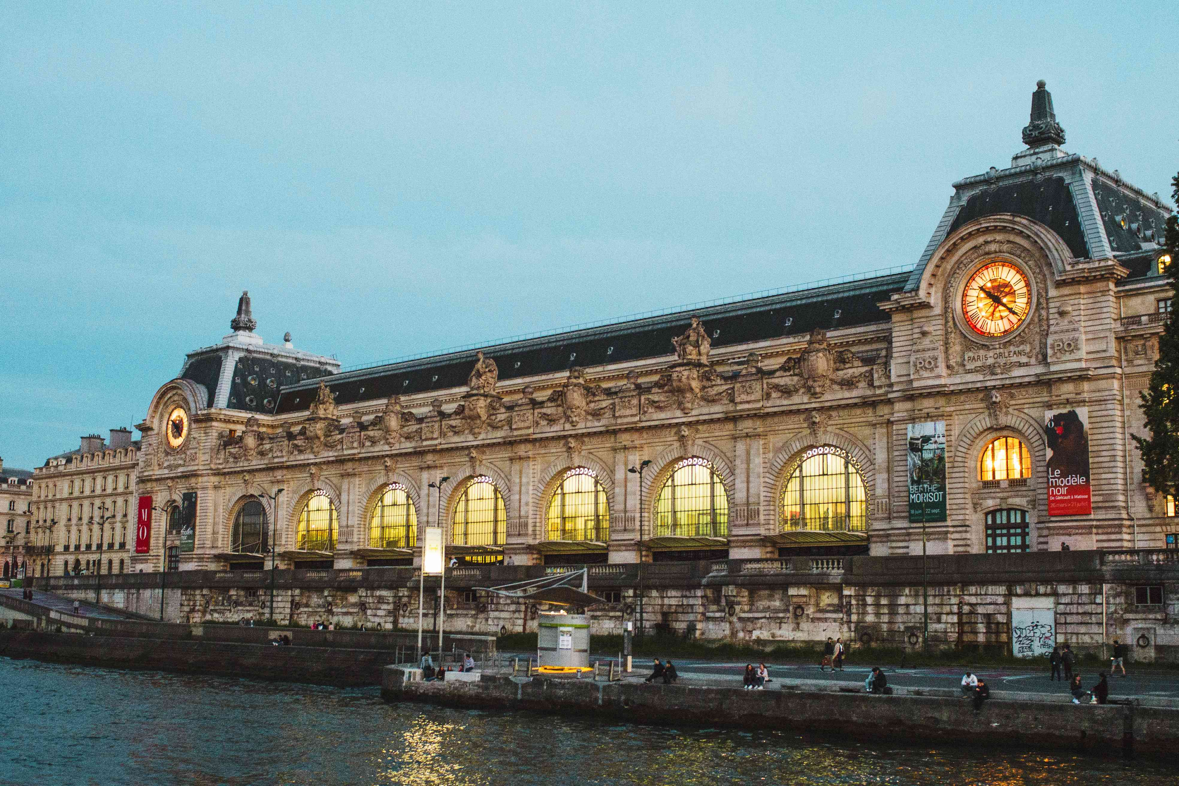 Musee D'Orsay lit up at night seen from the Seine