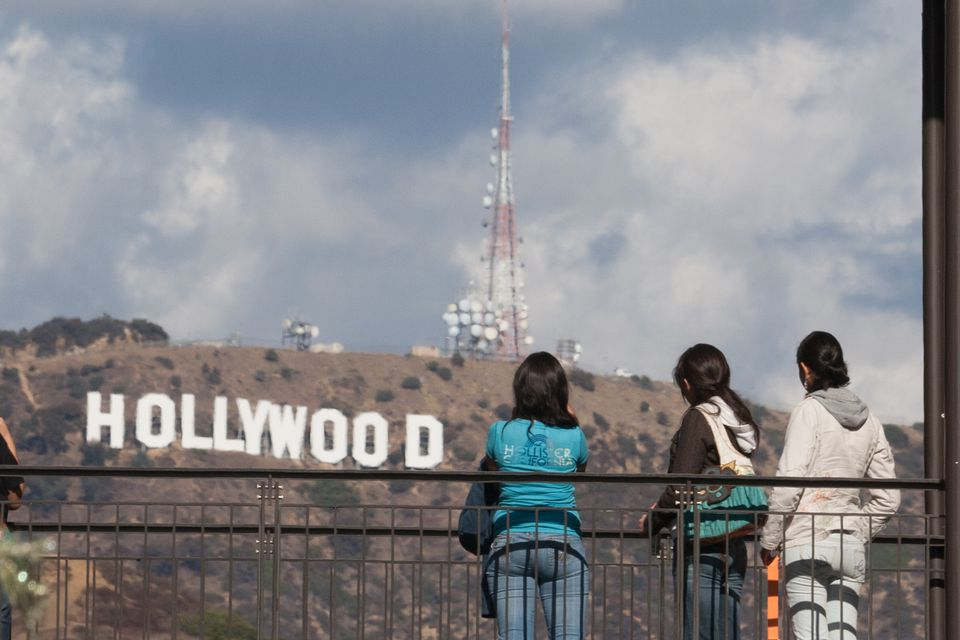 People on the viewing bridge at Hollywood & Highland looking at the Hollywood Sign