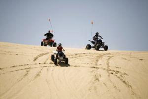 All-Terrain Vehicles Hitting the Dunes