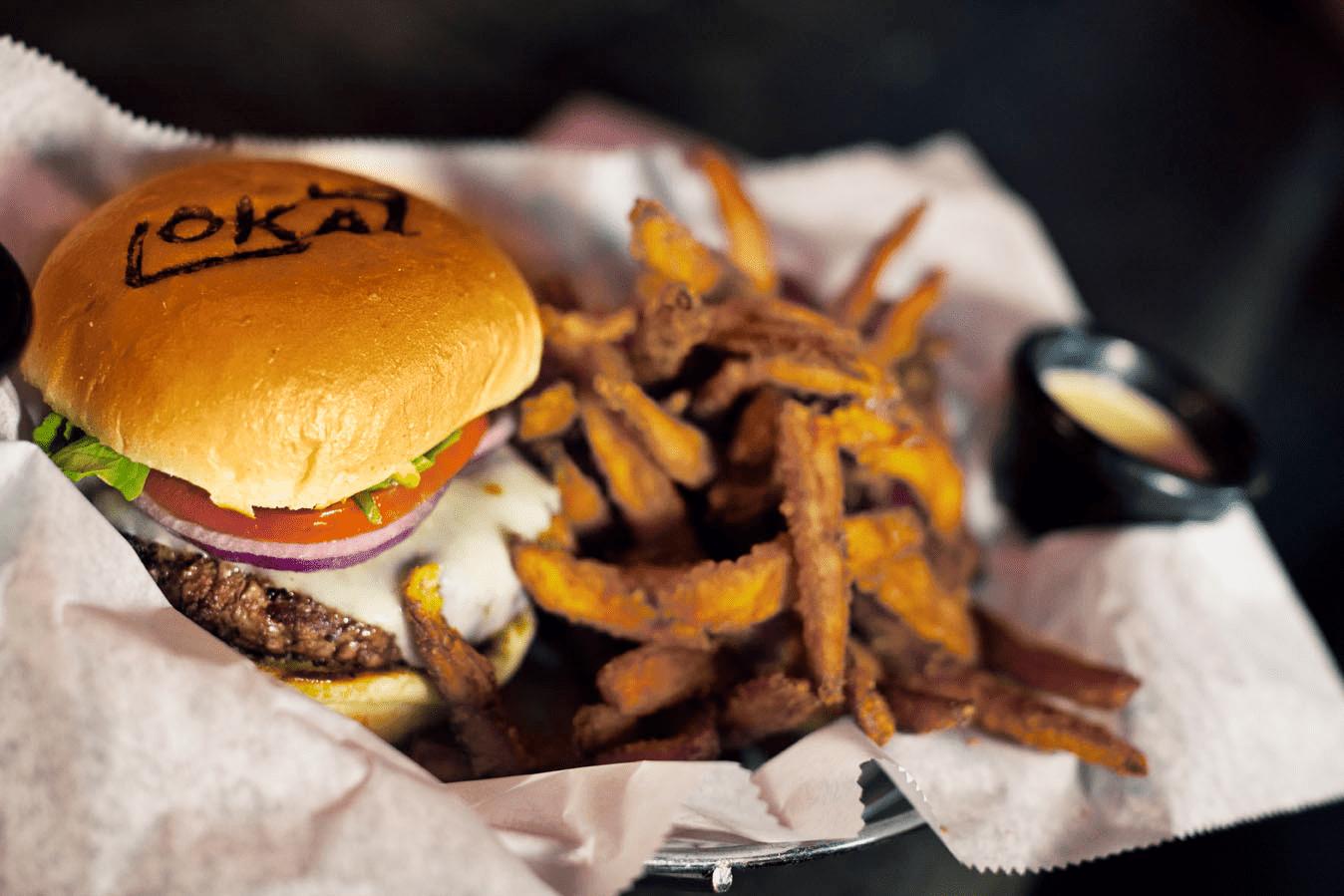 a burger and fries at Lokal