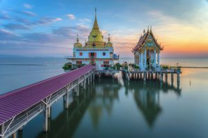 A beautiful temple in the sea during the sunset time in Thailand
