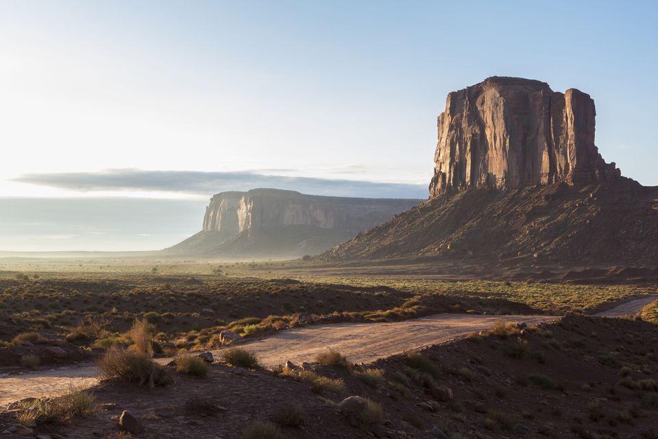 Rock formations overlooking desert landscape, Monument Valley, Utah, United States