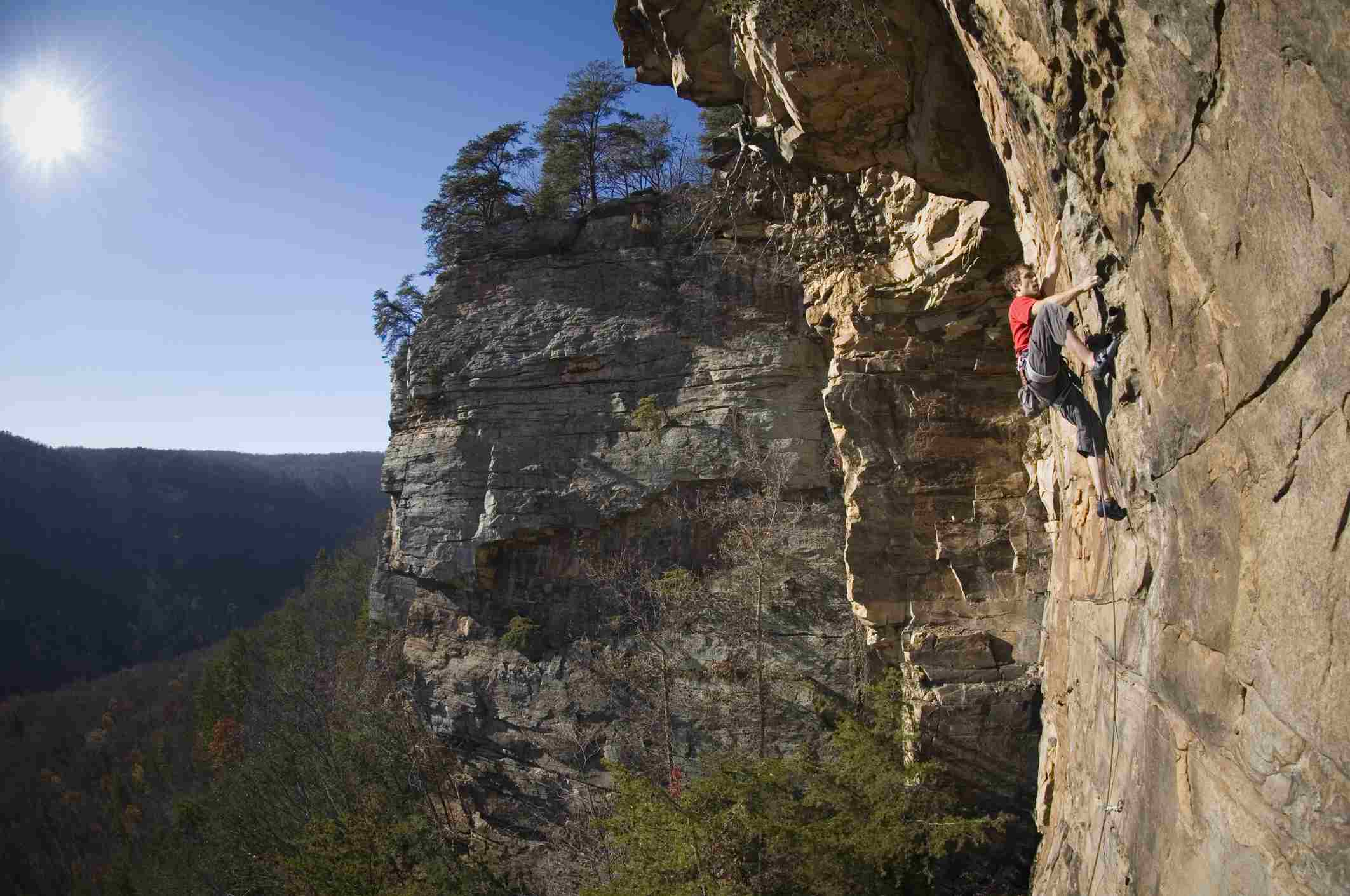 A man climbs a rock face in chattanooga