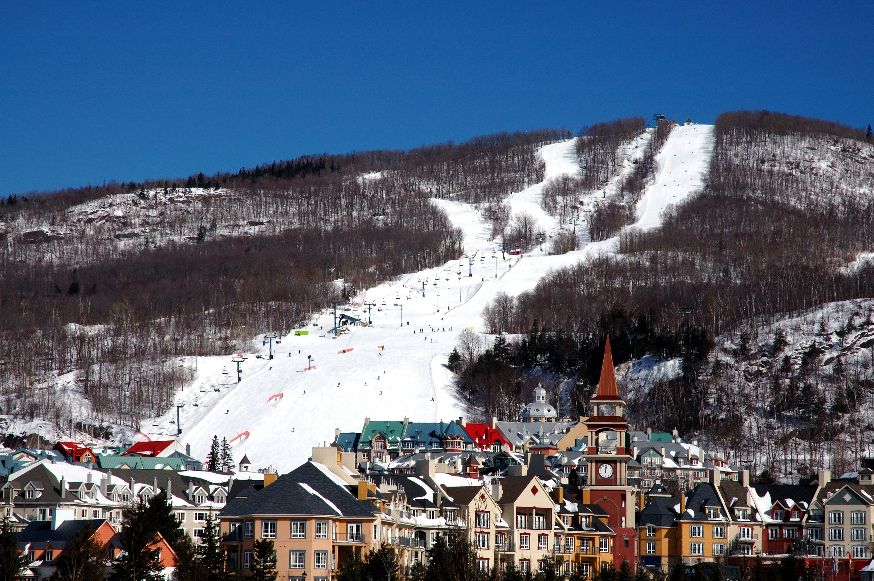 Panoramic view of a ski hill with village below in Mont-Tremblant, Quebec, Canada