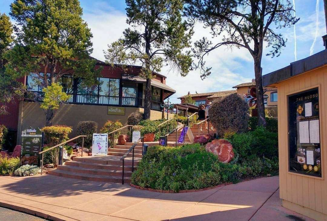Outdoor shopping center in sedona with a set of stairs leading up to the shops