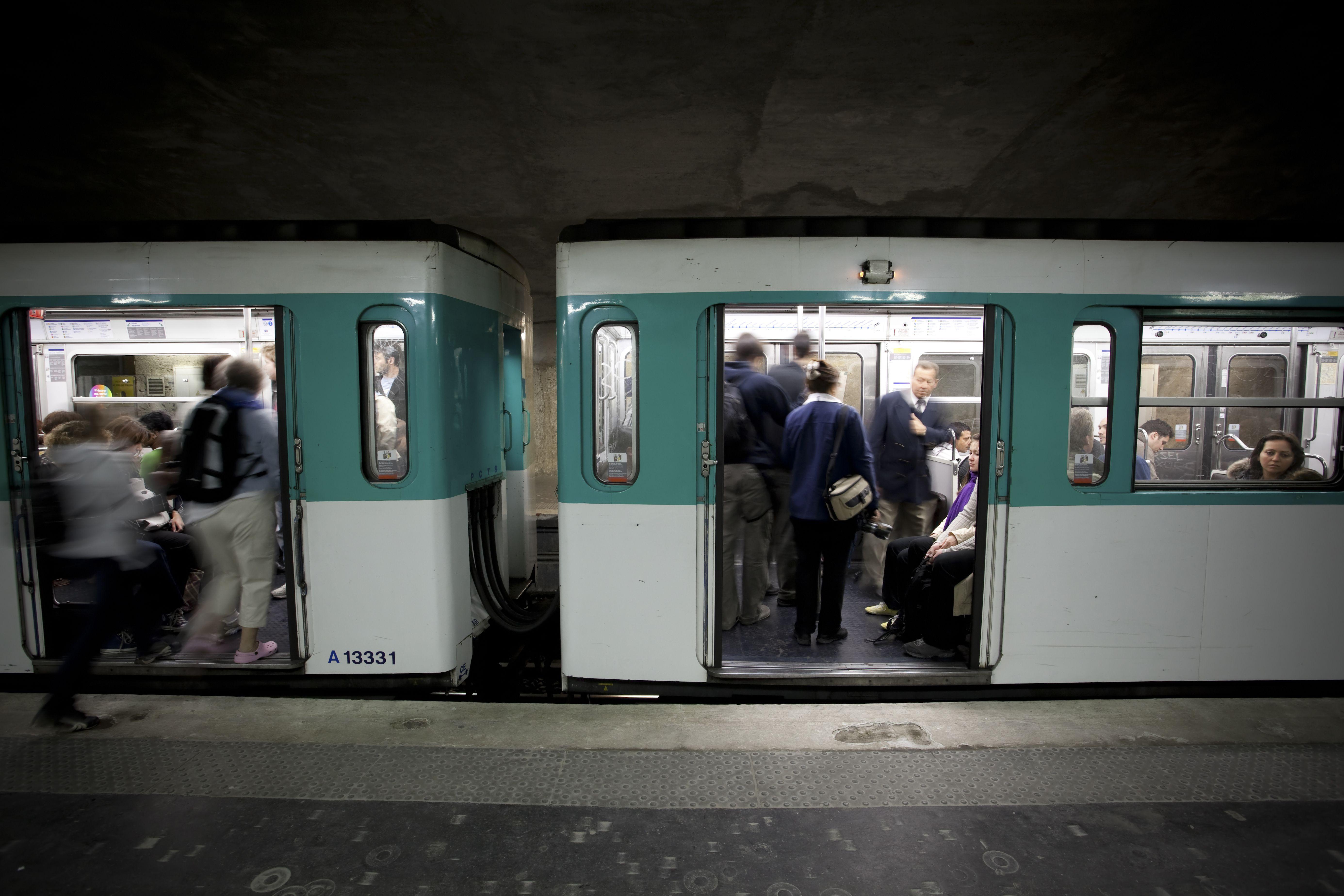 Boarding the metro in Paris, France.
