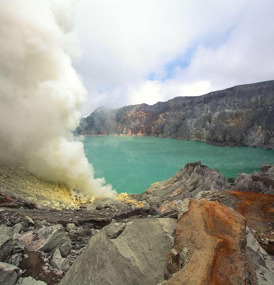 Kawah Ijen's smoking fumaroles and crater lake