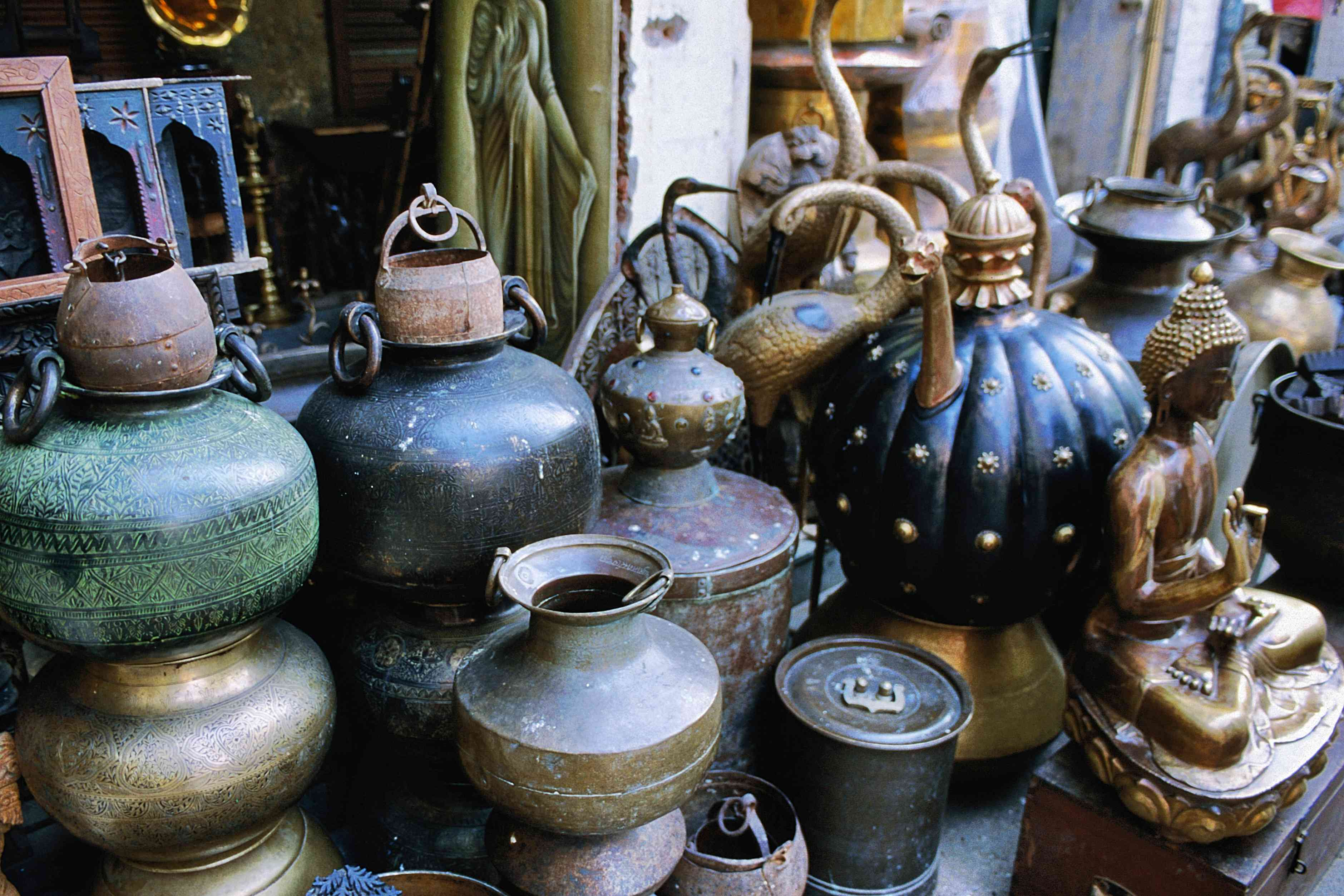Pots, pans, kettles and a small Buddha for sale in Sundar Nagar, an antique quarter of Delhi.