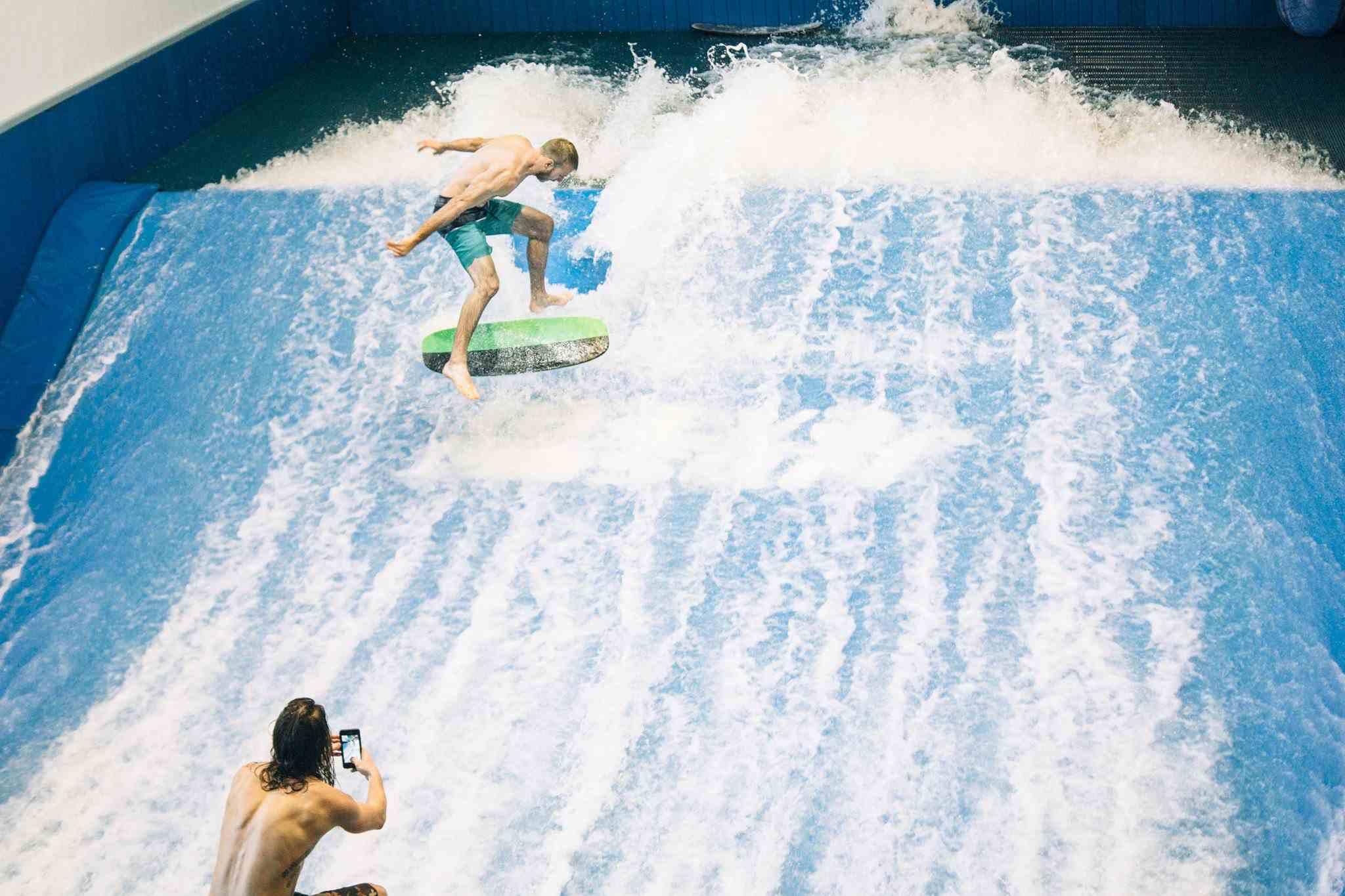 man falling of surf board at Maeva Surf