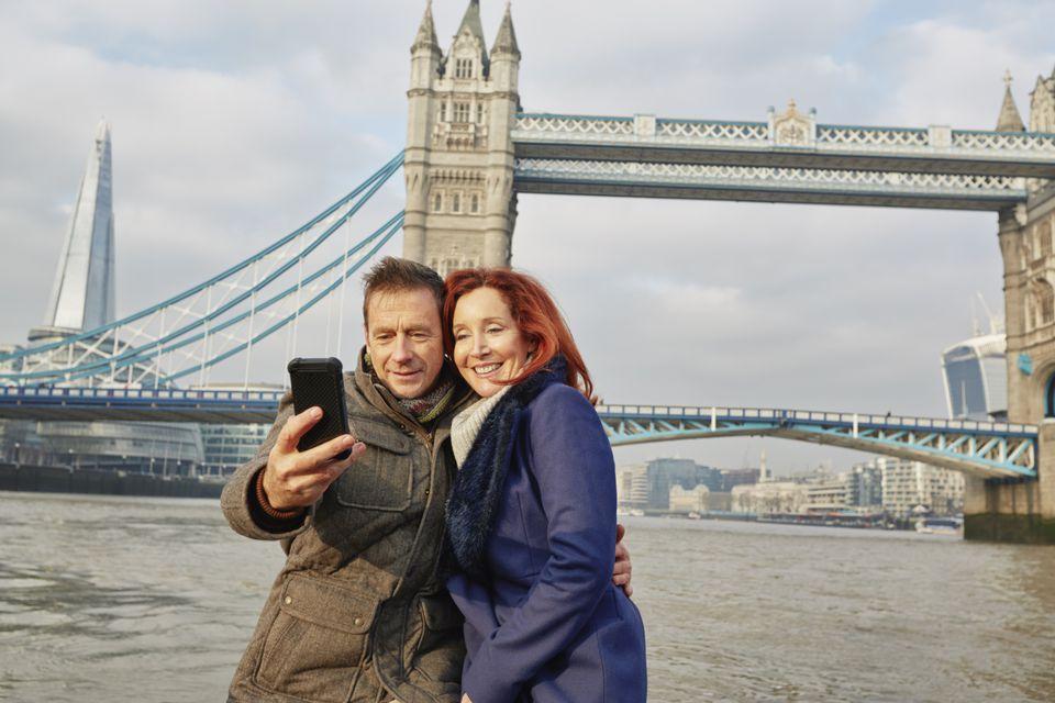 Couple taking selfie at Tower Bridge, London