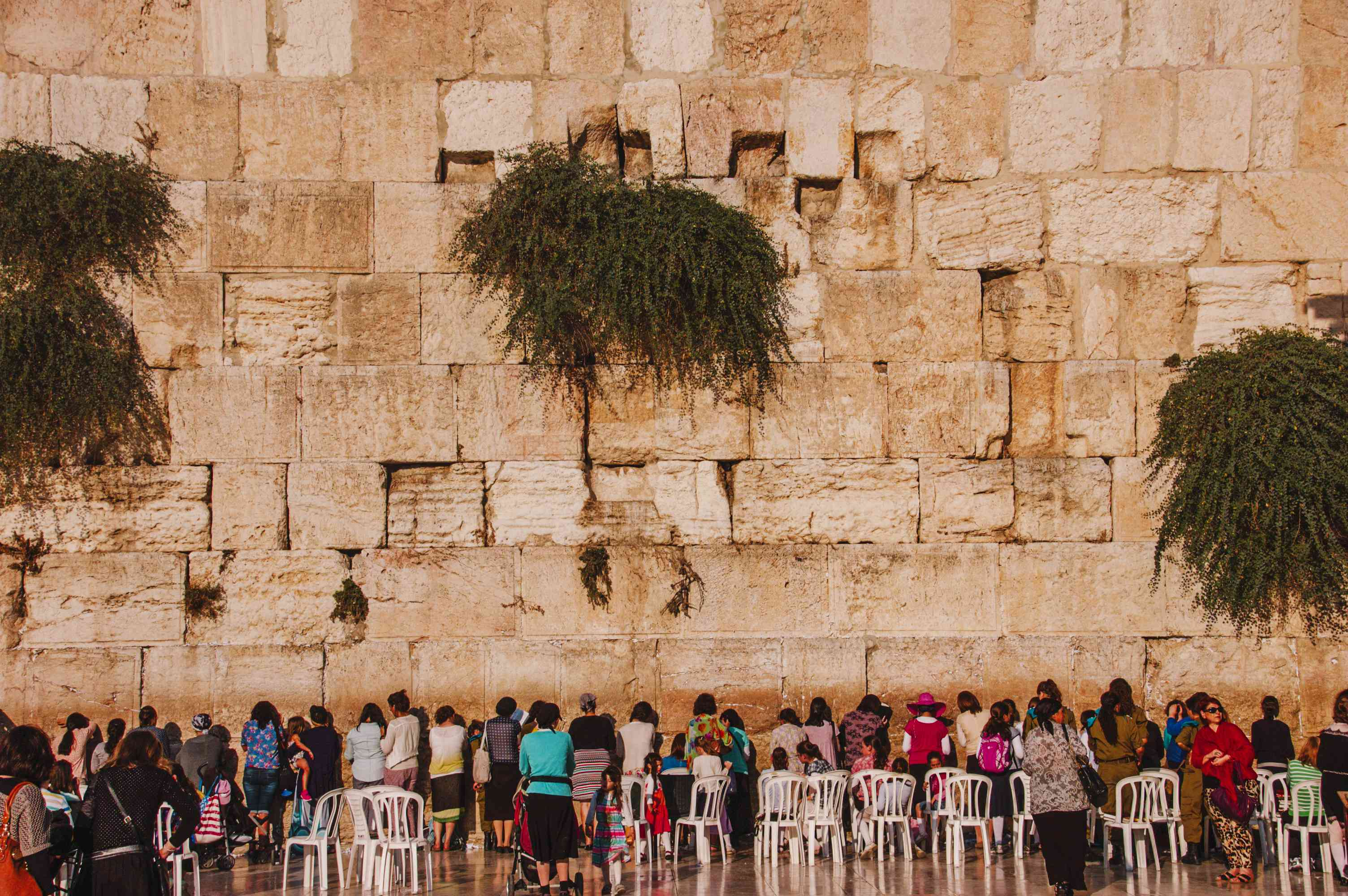 People standing at praying at the Western Wall